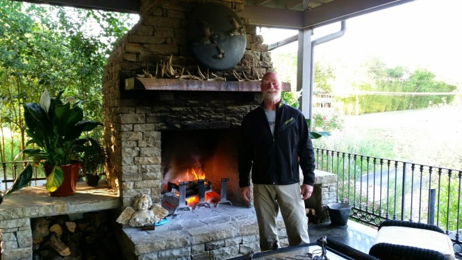 Jerry in front of the patio fireplace