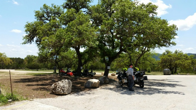 motorcycle-only parking under live oaks