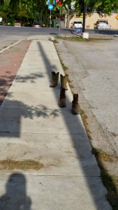 Boots on the motel sidewalk. Oddly, they were gone the next morning...
