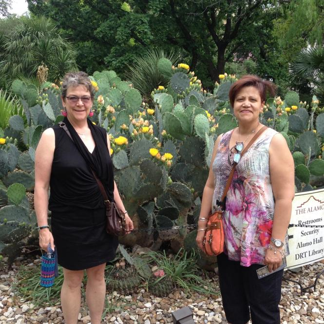Sisters from different mothers enjoy the Alamo courtyard