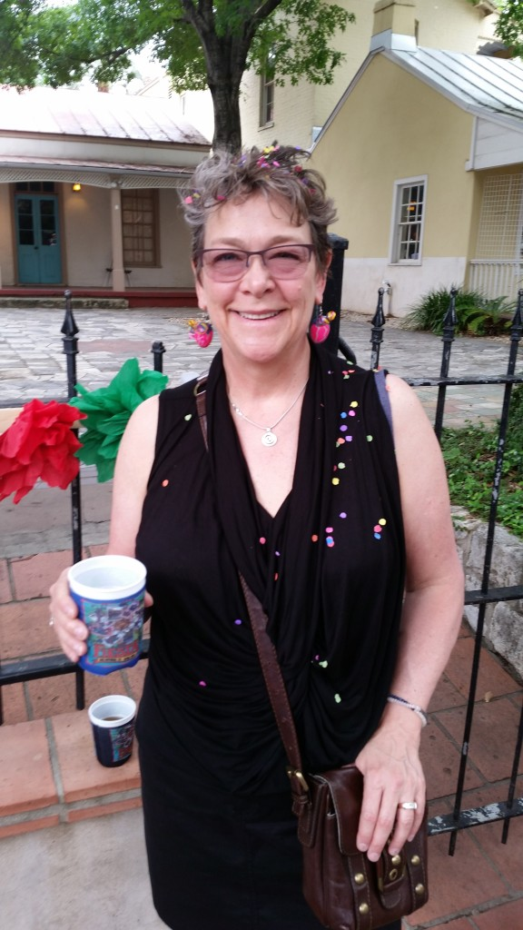 Cascarones are a Fiesta tradition. Egg shells, colorfully painted and filled with confetti, to crack on your friends' heads. Note my Cascarone earrings. :-)