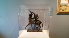 A tiny bronze of Wild Bill and his horse