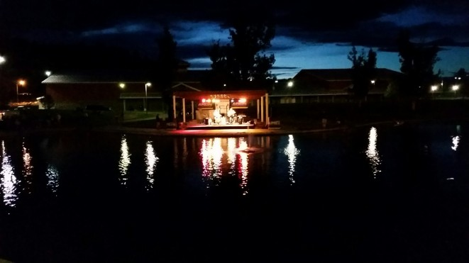 Watching live music and reflection on the lake
